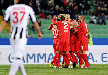 Jordan Henderson of Liverpool celebrates with teammates after scoring against Udinese during their UEFA Europa League Group A match on Thursday