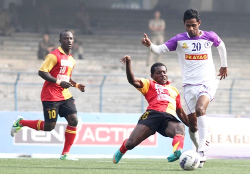 East Bengal's Orji penn tries to stop Prayag United's Asif Kottayil