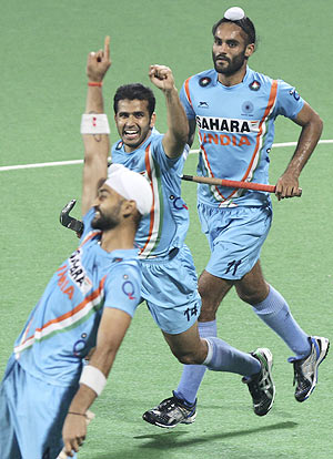 Indian hockey players celebrate after win