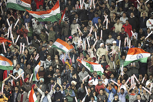 Fans wave India's national flag during the final