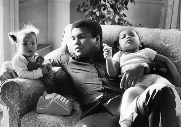Heavyweight boxer Muhammad Ali with his daughters Laila and Hanna at Grosvenor House in December 1978