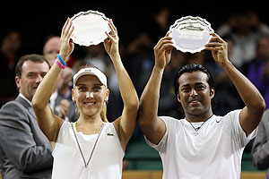 Elena Vesnina and Leander Paes hold up their runner up trophies after losing their Mixed Doubles final against Mike Bryan and Lisa Raymond on Sunday