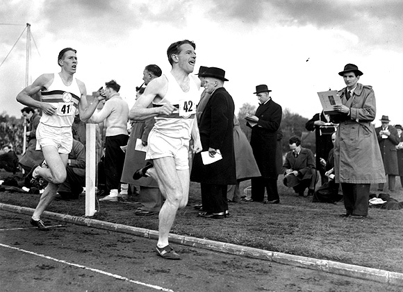 Britain's famed miler Roger Bannister (back) following pace man Chris Chataway, on the way to a new record of 3 minutes 59.4 seconds at Iffley Road, Oxford