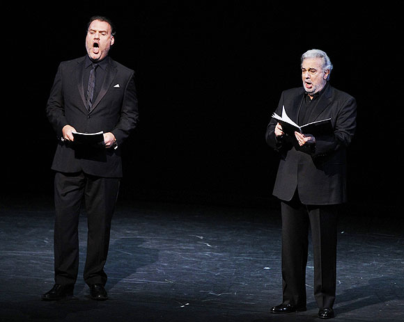 Opera singers Bryn Terfel (left) and Placido Domingo perform on stage during the opening ceremony of the International Olympic Committee session at London's Royal Opera House, on Monday