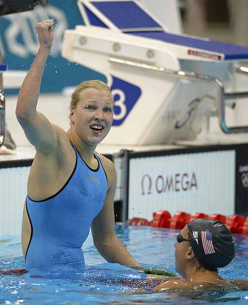 Lithuania's Ruta Meilutyte reacts after winning in the women's 100-meter breaststroke swimming final