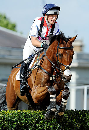 Zara Phillips of Great Britain riding High Kingdom negotiates a jump in the Eventing Cross Country Equestrian event on Monday