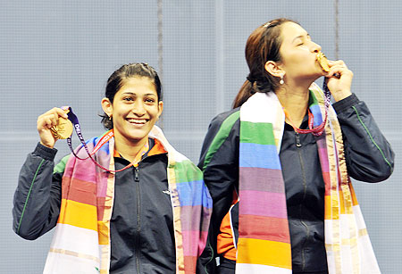 Ashwini Ponnappa (left) and Jwala Gutta with their Commonwealth Games gold medals