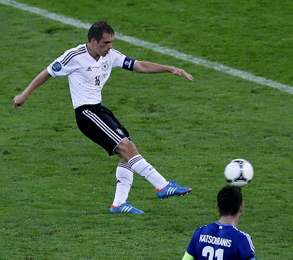 Philipp Lahm shoots to score the first goal for Germany