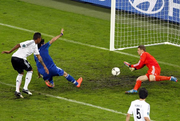 Giorgos Samaras (2nd left) scores the first goal for Greece beating Germany's goalkeeper Manuel Neuer