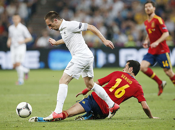 France's Franck Ribery (left) is challenged by Spain's Sergio Busquets