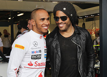 Rock musician Lenny Kravitz meets Lewis Hamilton in the McLaren Mercedes Paddock on Friday