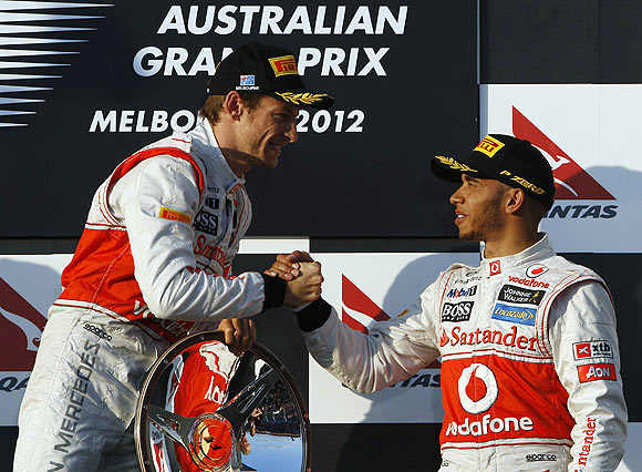 McLaren's Jenson Button is congratulated by teammate Lewis Hamilton on the podium after the Australian GP on Sunday