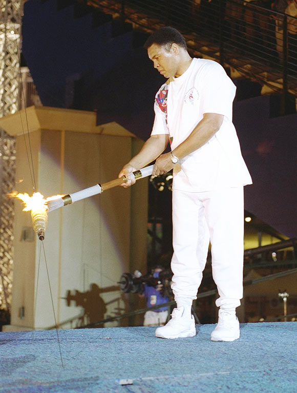 Muhammad Ali holds the torch before lighting the Olympic Flame during the Opening Ceremony of the 1996 Centennial Olympic Games in Atlanta, Georgia