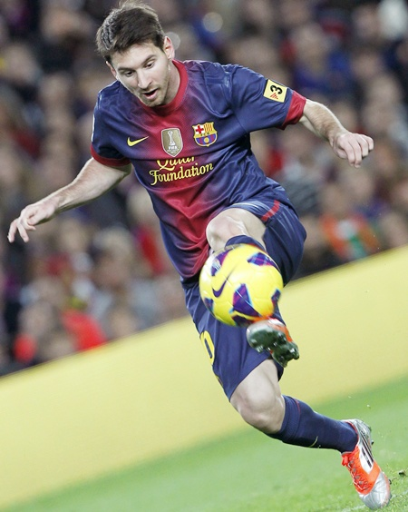 Barcelona's Lionel Messi keeps control of the ball
