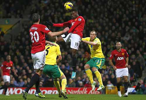 Danny Welbeck of Manchester United heads the ball in front of the Norwich City goal during their English Premier League match
