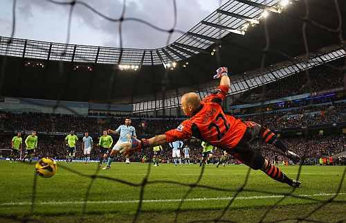 Sergio Aguero of Manchester City scores his team's second goal, from the penalty spot, to make the score 2-0 during the Barclays Premier League match
