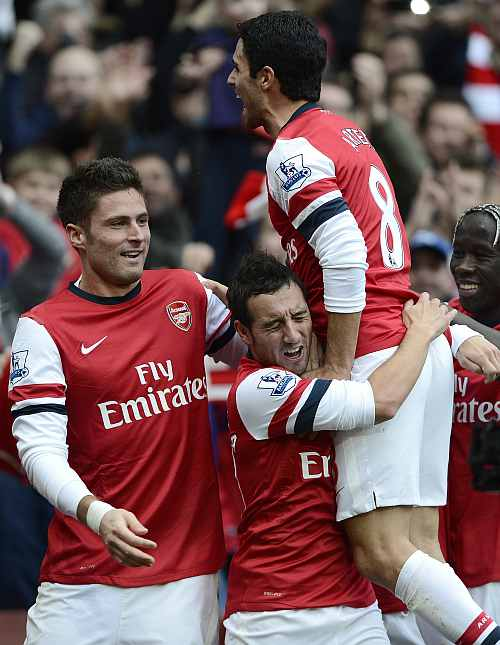 Arsenal's Santi Cazorla (C) celebrates with team mates after scoring against Tottenham Hotspur during their English Premier League match