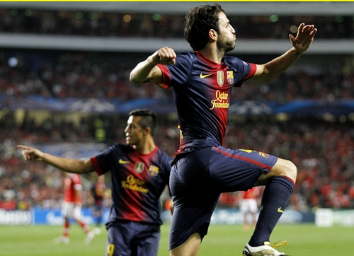 Barcelona's Cesc Fabregas (right) celebrates his goal with teammate Alexis Sanchez