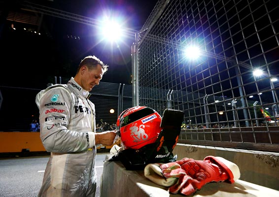 Michael Schumacher of Mercedes retires early after crashing into the back of Jean-Eric Vergne of France and Scuderia Toro Rosso during the Singapore GP on September 23, 2012