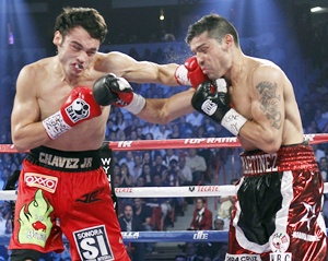 WBC middleweight champion Julio Cesar Chavez Jr. (left) of Mexico fights against Sergio Martinez of Argentina