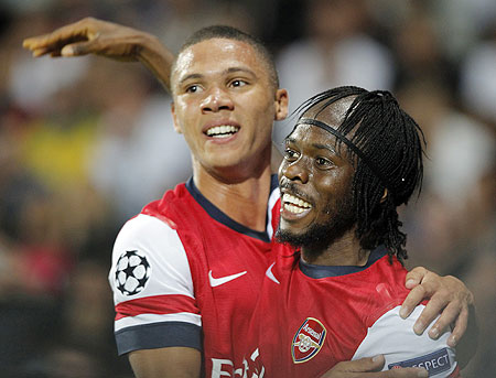 Arsenal's Gervinho (right) celebrates with teammate Kieran Gibbs after scoring the second goal against Montpellier