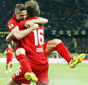 Liverpool's Sebastian Coates and Fabio Borini (left) celebrate