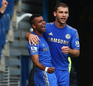 Ashley Cole (left) with Branislav Cole after scoring the goal