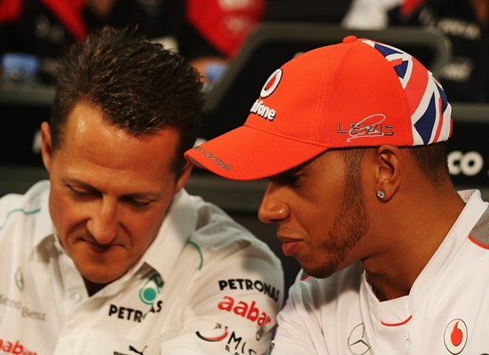 Lewis Hamilton (right) with Michael Schumacher