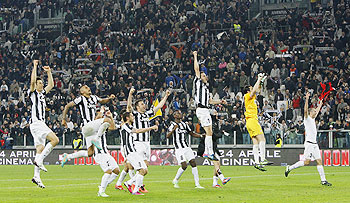 Jubilant Juventus players after their win over AC Milan on Sunday