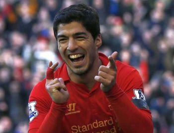 Suarez has 70m pound 'escape' clause in new Liverpool contract