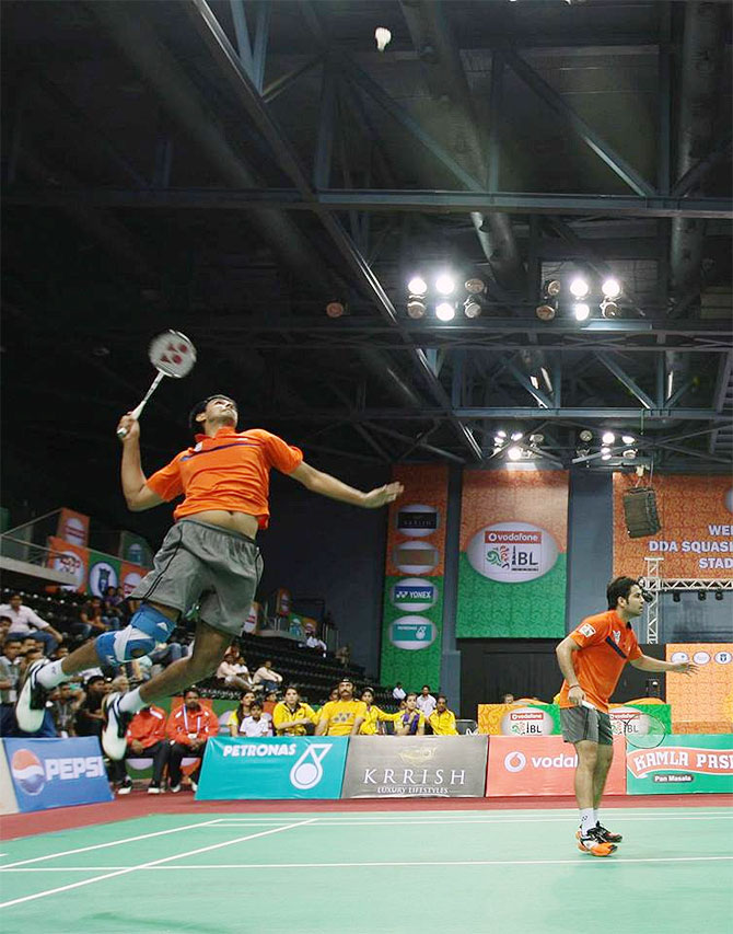 Mumbai's Pranaav Jerry Chopra attempts a smash against the pair of Carston Mogensen and Akshay Dewalkar during their men's doubles