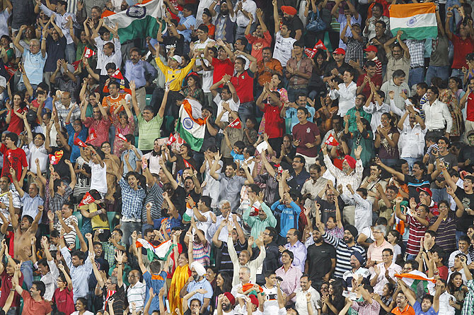 India's hockey fans cheer their team during the 2010 Commonwealth Games