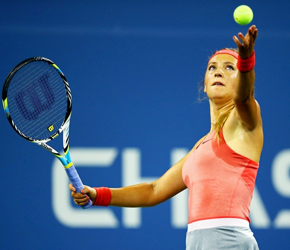 Victoria Azarenka of Belarus tosses the ball in the air to serve