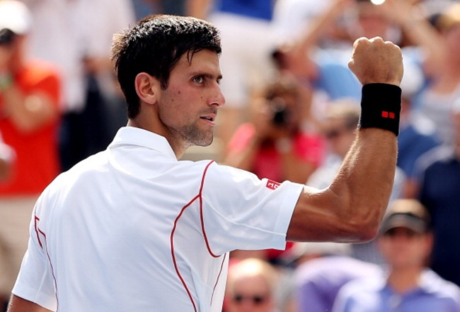 Novak Djokovic of Serbia celebrates victory after his men's singles second round match against Benjamin Becker of Germany