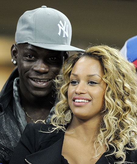 Mario Balotelli and girlfriend Fanny Neguesha attend the Champions League match between AC Milan and Barcelona on Wednesday