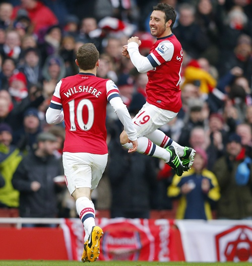 Santi Cazorla (right) of Arsenal celebrates