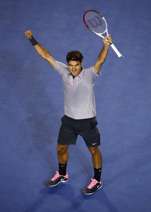 Roger Federer of Switzerland celebrates defeating Jo-Wilfried Tsonga of France in their men's singles quarter-final match