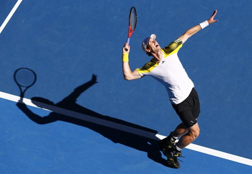 Andy Murray of Britain serves to Jeremy Chardy of France during their men's singles quarter-final match