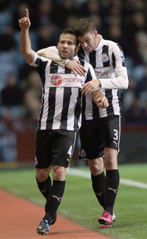 Yohan Cabaye of Newcastle United celebrates scoring the second goal against Aston Villa at Villa Park