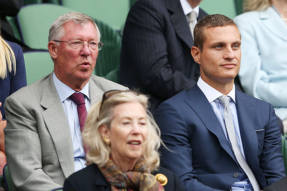Sir Alex Ferguson and Nemanja Vidic watch the Wimbledon men's singles quarter-final between Andy Murray and Fernando Verdasco at the All England Lawn Tennis and Croquet Club at Wimbledon in July 2013