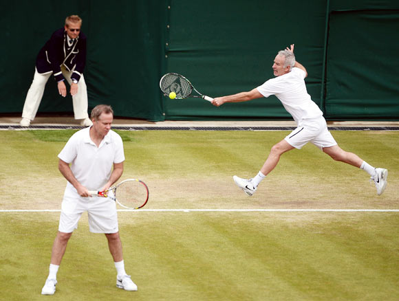 John McEnroe (right) in action with Patrick McEnroe
