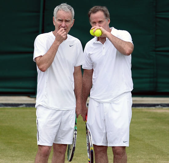 John McEnroe (left) speaks to Patrick McEnroe