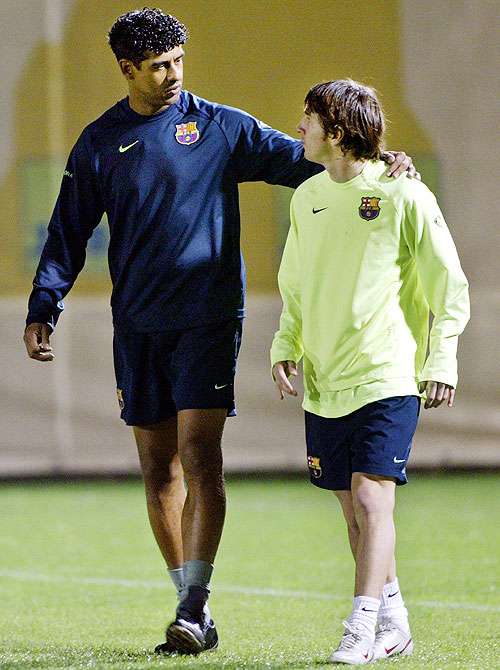 Former Barcelona coach Frank Rijkaar with Lionel Messi in November 2005