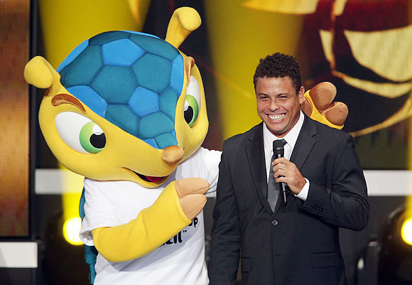 Mascot Fuleco of FIFA World Cup 2014 in Brazil poses with Ronaldo