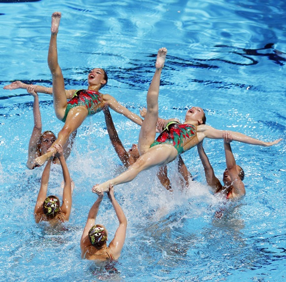 Japan's team perform in the synchronised swimming free combination routine