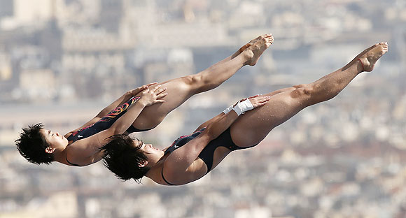 China's Liu Huixia and Chen Ruolin perform a dive at the women's synchronised 10m platform preliminary during the World Swimming Championships at the Montjuic municipal pool in Barcelona on Monday