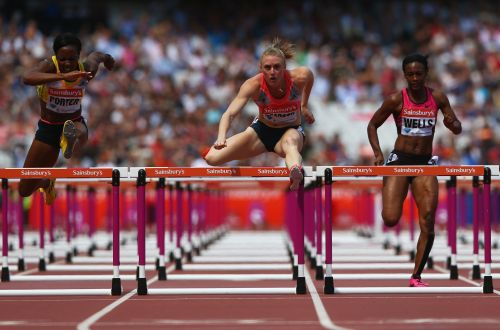 Tiffany Porter of Great Britain, Sally Pearson of Australia and Kellie Wells of the United States compete in the Women's 100m Hurdles during day two of the Sainsbury's Anniversary Games - IAAF Diamond League 2013 at The Queen Elizabeth Olympic Park