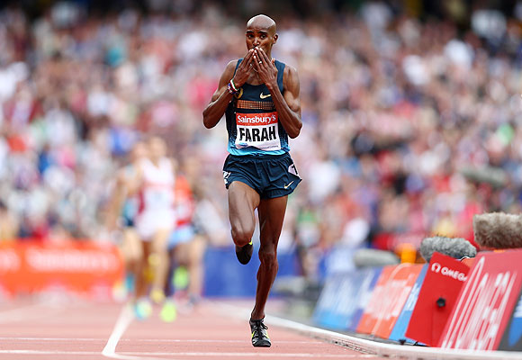 Mo Farah of Great Britain celebrates as he crosses the line in first place in the Men's 3000m during day two of the Sainsbury's Anniversary Games - IAAF Diamond League 2013 at The Queen Elizabeth Olympic Park in London on Saturday