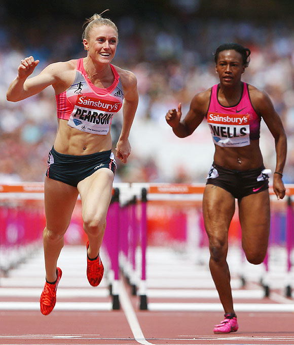 Sally Pearson of Australia crosses the line to win the Women's 100m Hurdles during day two of the Sainsbury's Anniversary Games - IAAF Diamond League 2013 at The Queen Elizabeth Olympic Park in London on Saturday