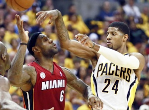 Indiana Pacers' Paul George (right) passes over Miami Heat's LeBron James